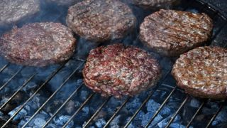 Hamburgers on a charcoal grill