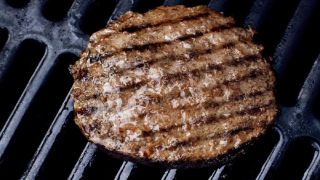 burger on a gas grill